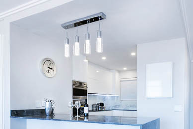 This picture shows track lighting installation in Pasadena. The lights are located above the kitchen island.